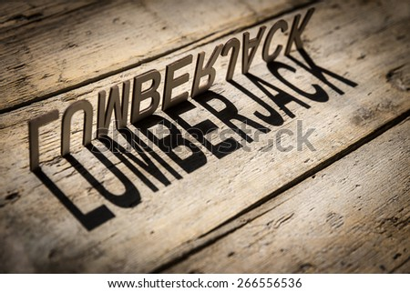 wooden letters on old aged wooden table build the shadow word lumberjack, vintage style
