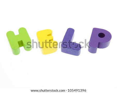 """Wooden letters spelling the word  """"help""""  on white background. - stock photo"""