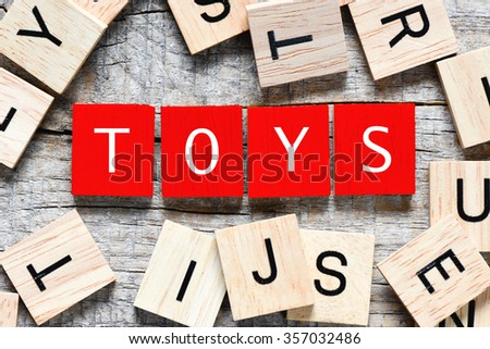 Wooden letters spelling toys  - stock photo