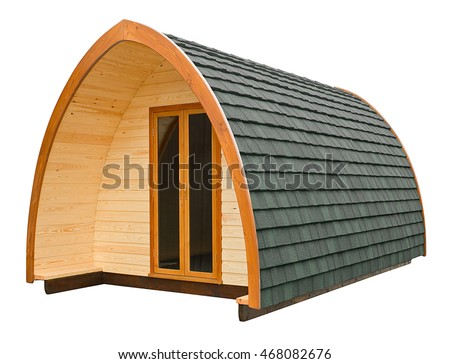 Wooden log cabin often used as a holiday lodge for glamping holidays isolated on a white background