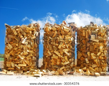 Wooden logs for combustion in a biomass oven - stock photo