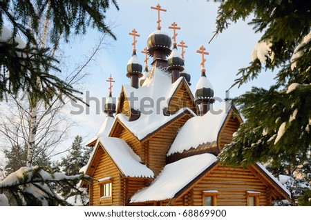 Wooden lonely church in the winter forest - stock photo