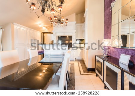 Wooden long table in exclusive dining room - stock photo