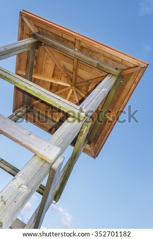 Wooden lookout tower on the beach view from below - stock photo