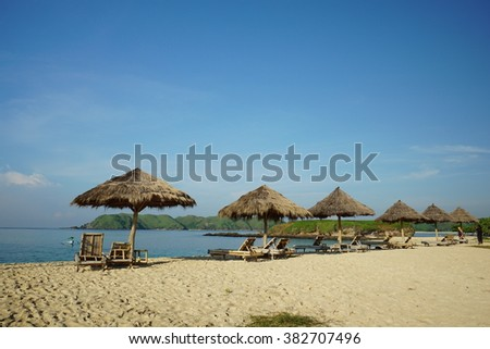 Wooden lounge at Lombok beach, Indonesia - stock photo