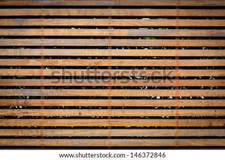 wooden louver on building, wall of wooden planks  - stock photo