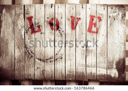 Wooden love dyed wooden plate in retro style - stock photo