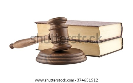 wooden mallet and books is isolated on a white background - stock photo