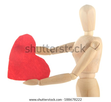 Wooden mannequin holding big red heart isolated on white - stock photo