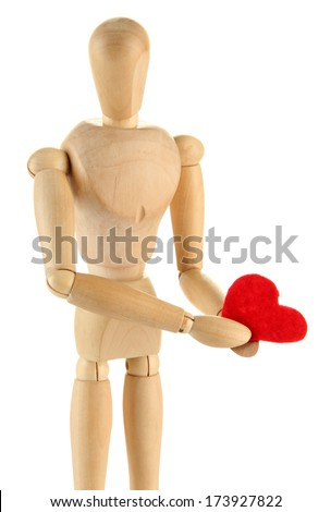Wooden mannequin holding red heart isolated on white - stock photo