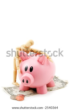 Wooden mannequin hugs his pink piggy bank - isolated on white - bank standing on dollar bill with change in front