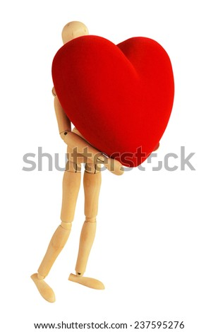 Wooden mannequin with red velvet heart isolated on white background - stock photo
