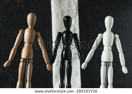 Wooden Mannequins on black background - stock photo
