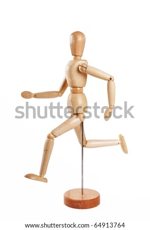 Wooden marionette running isolated on white