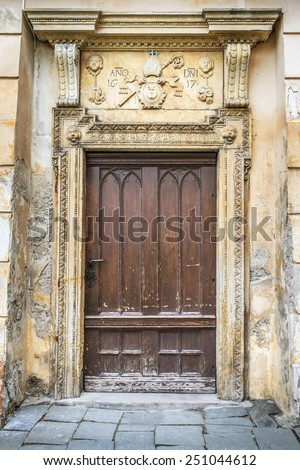 Wooden massive door in an ancient fortress Europe.