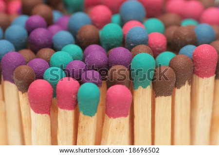 Wooden matches of different colors. - stock photo