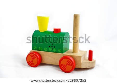 Wooden miniature railway - eco toy for children isolated on white. - stock photo