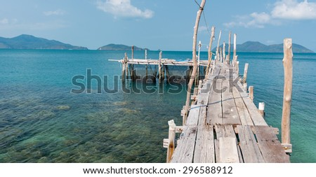 wooden mooring at the beach of the Koh Ku Dee, Thailand - stock photo