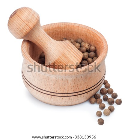 Wooden mortar for grinding dry spice with allspice isolated on white background - stock photo