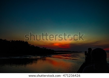 Wooden motor boat in a sea at sunset