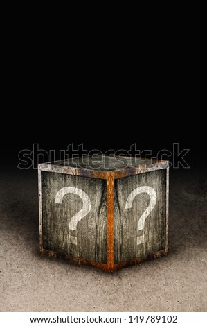 Wooden mystery box with question marks - stock photo