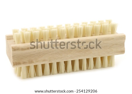wooden nail brush on a white background - stock photo