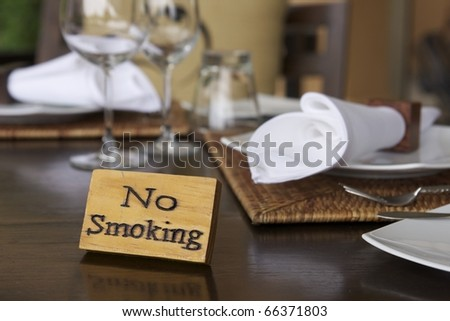 wooden no smoking sign on wood dining table in restaurant - stock photo