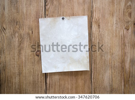 Wooden old billboard with blank sheet for notes - stock photo