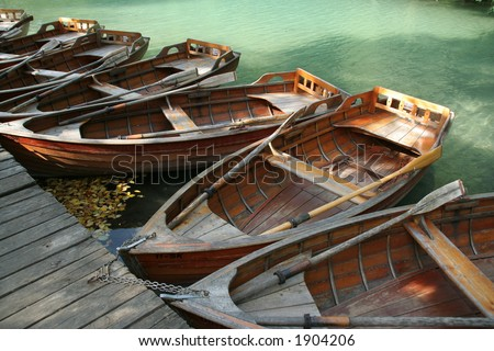 Wooden old-fashioned boats for rent - stock photo