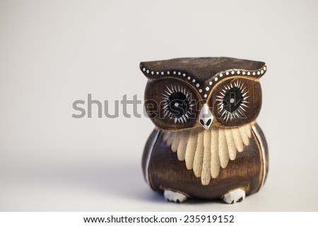 Wooden owl statue - stock photo