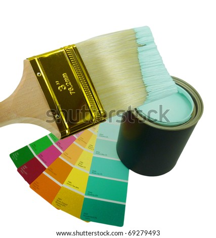 Wooden paint brush tipped with paint hovering over an open can of aqua blue paint and a rainbow of paint chips, isolated on white with clipping path