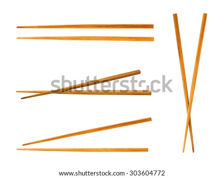 Wooden pairs of chopsticks on white background - stock photo