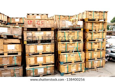 Wooden pallets for shipment in warehouse - stock photo