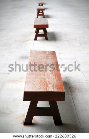 wooden park bench in the park - stock photo