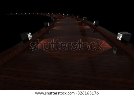 Wooden path with lights - stock photo