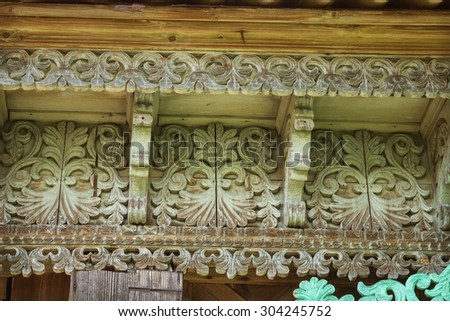 Wooden patterns on the eaves of an old house. Russia - stock photo
