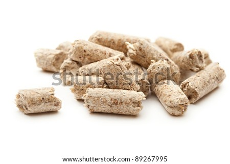 Wooden pellets isolated on white - stock photo