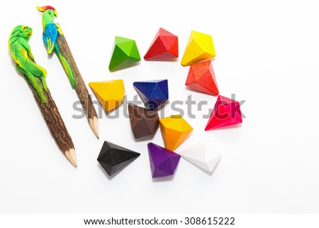 Wooden pencils and colored crayons isolated on white background - stock photo