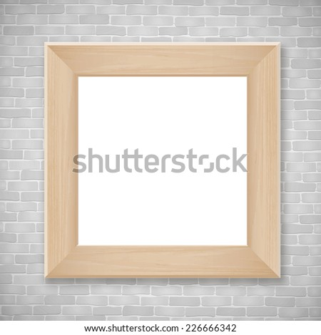 Wooden photo frame on vintage brick wall texture background with area for copy space. - stock photo