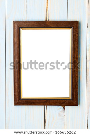 Wooden picture frame on a wooden blue background - stock photo