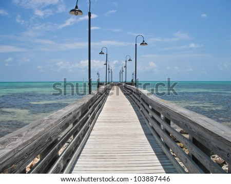 wooden pier and boardwalk over ocean in the Florida Keys - stock photo