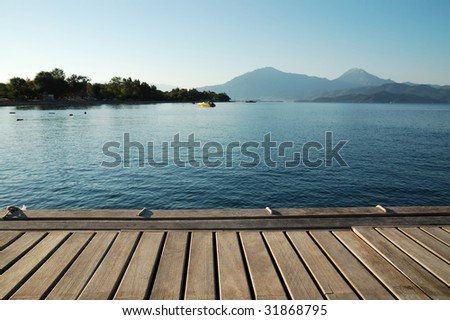 Wooden pier by the sea - stock photo