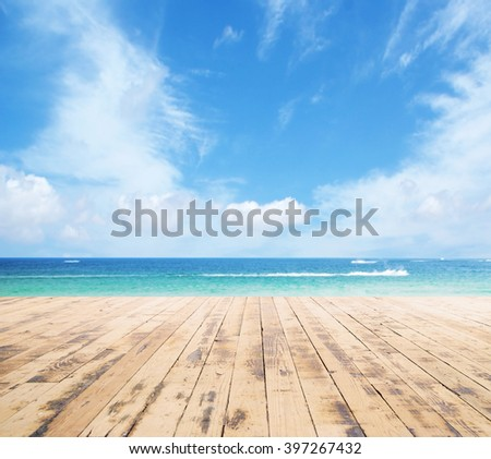 Wooden pier, exotic sea and a blue sky. Beautiful summer background. Vacation and traveling concept. - stock photo