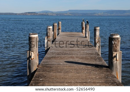 Wooden pier in lake - stock photo