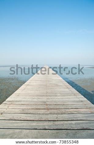 Wooden Pier in Thai Sea - stock photo