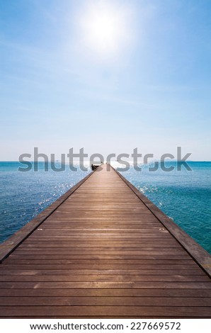Wooden pier in the blue sea on Samui island, Thailand. - stock photo