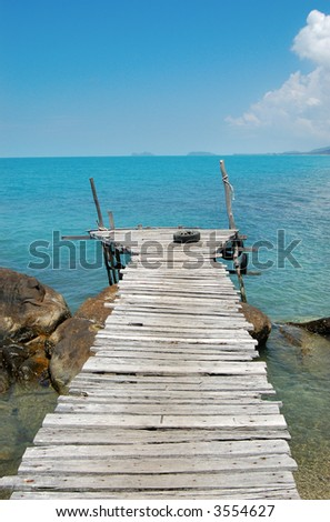 Wooden Pier in turquoise water, Thailand - stock photo