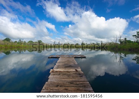 Wooden pier on a lake in Guatemala. - stock photo