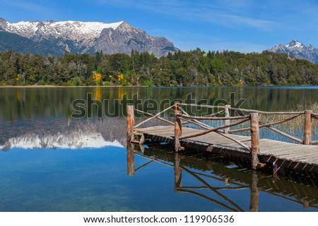 Wooden pier on a mountain lake, Patagonia, Argentina - stock photo