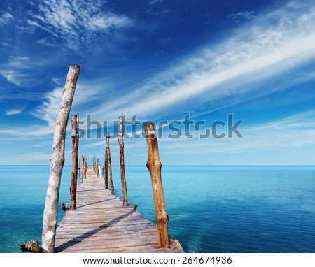 Wooden pier on a tropical island, sea and blue sky, Thailand